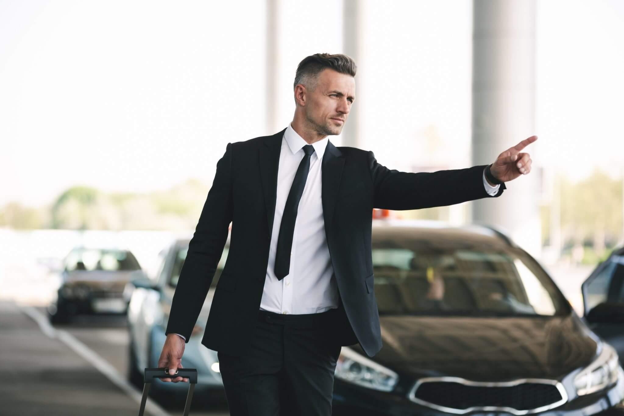 Hommes d'affaires appelant un taxi - Non-Stop Taxi Lille